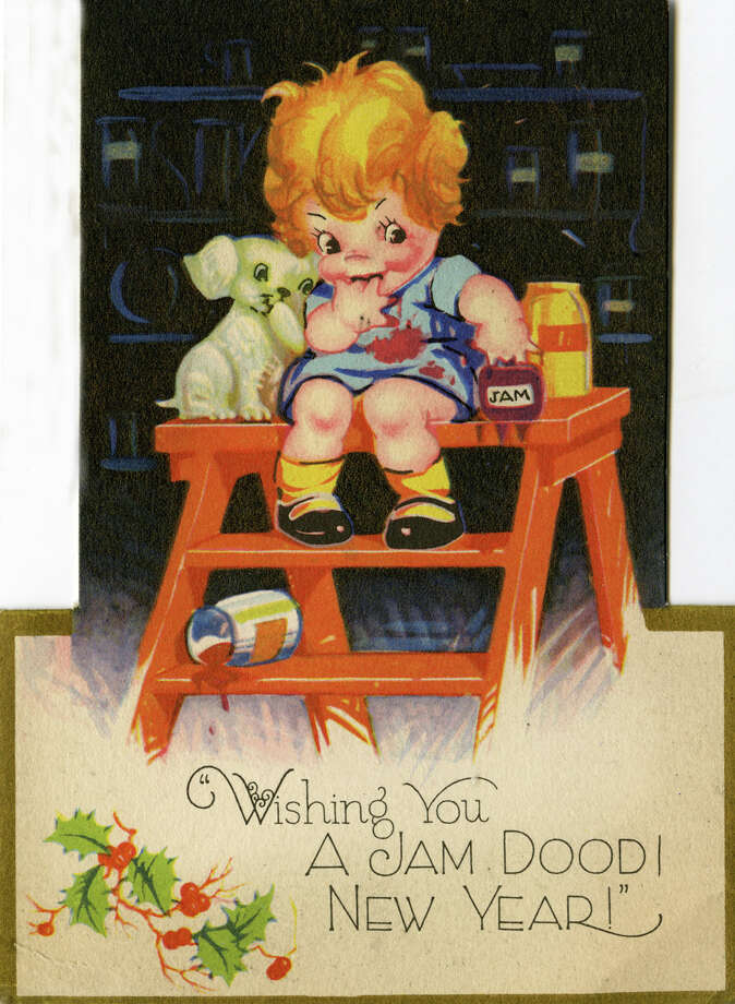 "A colorful vintage cartoon greeting card from around 1930 depicts a caricature of a young child with its hand in a jar of jam as a puppy looks on and reads,  ""Wishing you a jam doodi New Year!"" Photo: Donaldson Collection, Getty Images / Michael Ochs Archives"