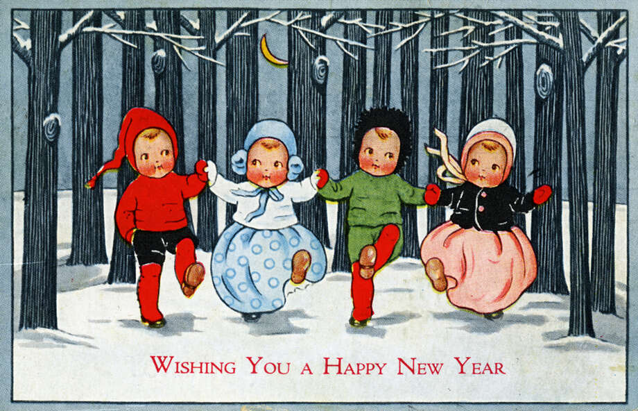 "This greeting card reads ""Wishing You a Happy New Year"" and features a group of highly stylized cartoon children in a snowy copse as they perform one-legged high kicks while holding hands and dressed in winter clothes, circa 1915. Photo: Transcendental Graphics, Getty Images / Archive Photos"