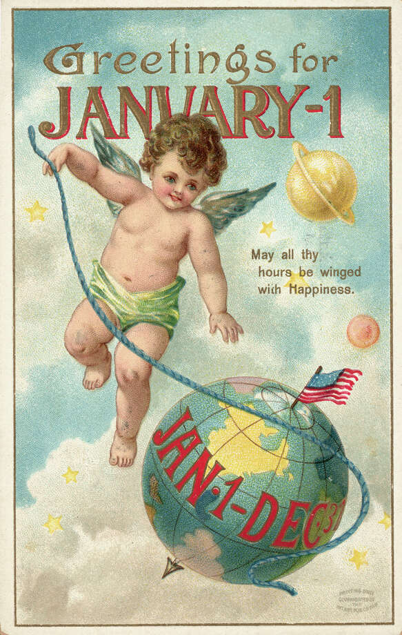 Baby New Year flies above the globe, wishing holiday greetings on a New Year's postcard, circa 1900. Photo: Hulton Archive, Getty Images / Hulton Archive