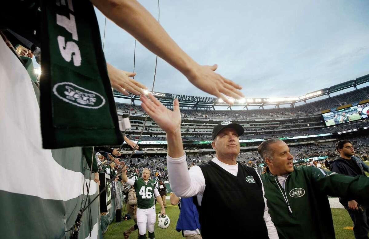New York Jets head coach Rex Ryan, center, greets fans after an NFL football game against the Cleveland Browns, Sunday, Dec. 22, 2013, in East Rutherford, N.J. The Jets won the game 24-13. (AP Photo/Kathy Willens) ORG XMIT: ERU124