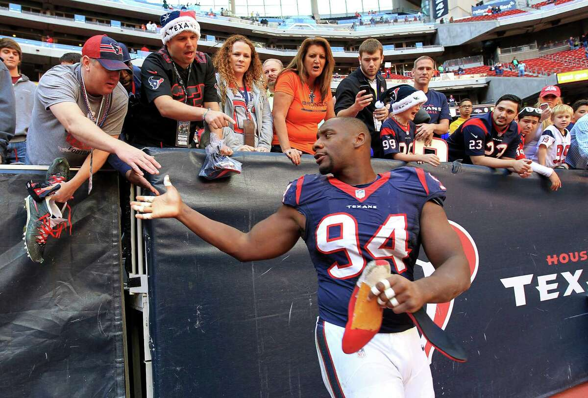 One lucky fan Sunday saw Broncos quarterback Peyton Manning set an NFL record for touchdown passes in a season and went home with a pair of Texans defensive end Antonio Smith's shoes after a handshake.