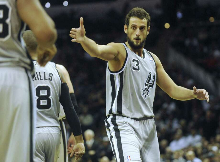 Marco Belinelli has played for five teams in seven seasons, but his 54 percent 3-point shooting so far makes him a bargain. Photo: Billy Calzada / San Antonio Express-News / San Antonio Express-News