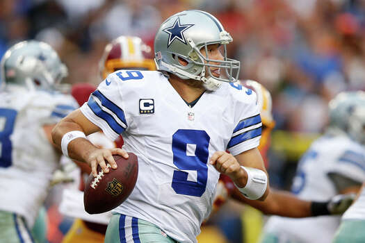 Dallas Cowboys quarterback Tony Romo scrambles with the ball during the second half of an NFL football game against the Washington Redskins in Landover, Md., Sunday, Dec. 22, 2013. The Cowboys defeated the Redskins 24-23. Photo: Evan Vucci, Associated Press / AP