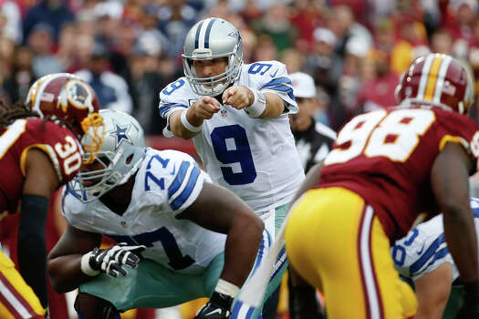 Dallas Cowboys quarterback Tony Romo points down the line during the first half of an NFL football game against the Washington Redskins in Landover, Md., Sunday, Dec. 22, 2013. Photo: Alex Brandon, Associated Press / AP