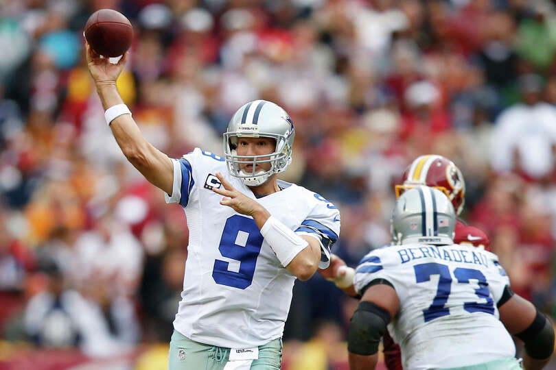 Dallas Cowboys quarterback Tony Romo passes the ball during the first half of an NFL football game a