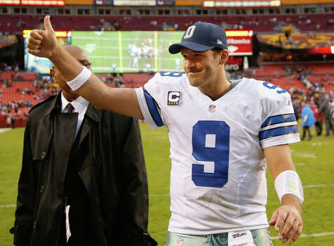 Dallas Cowboys quarterback Tony Romo flashes a thumbs-up as he walks off the field after the Cowboys defeated the Washington Redsksins 24-23 in an NFL football game in Landover, Md., Sunday, Dec. 22, 2013. Photo: Evan Vucci, Associated Press / AP