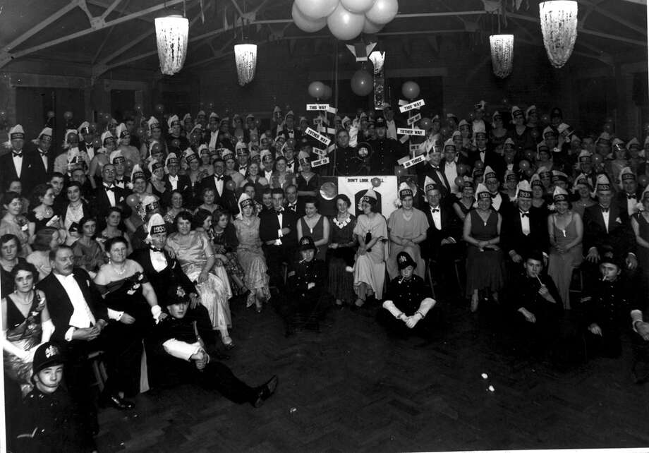 Hats emblazoned with 1935 are worn to celebrate the new year at a belisha Beacon Ball. Photo: Douglas Miller, Getty Images / Hulton Archive