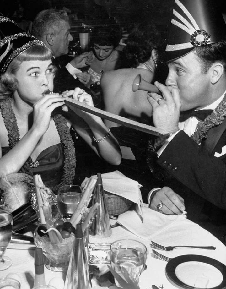 Dallas 6th-grade schoolteacher Nell Owens noisily celebrates New Year's Eve, Dec. 31, 1952, with her husband George in a nightclub in Hollywood, Calif., during a trip she was given by winning the Our Miss Brooks CBS Radio-sponsored Prettiest Teacher in the U.S. contest. Photo: Ed Clark, Getty Images / Time Life Pictures