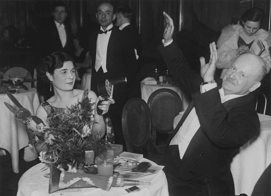 Revelers celebrate New Year's Eve at the Piccadilly Restaurant in London on Dec. 31, 1931. Photo: Sasha, Getty Images / Hulton Archive
