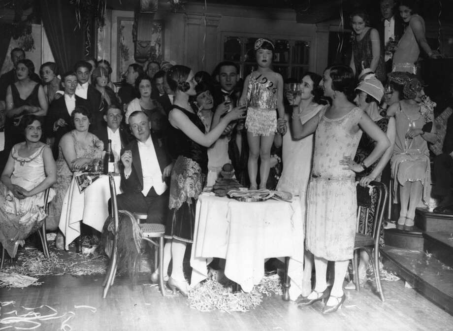 "A doll is dubbed ""Miss 1926"" at a New Year's Party on Jan. 1, 1926. Photo: Topical Press Agency, Getty Images / Hulton Archive"