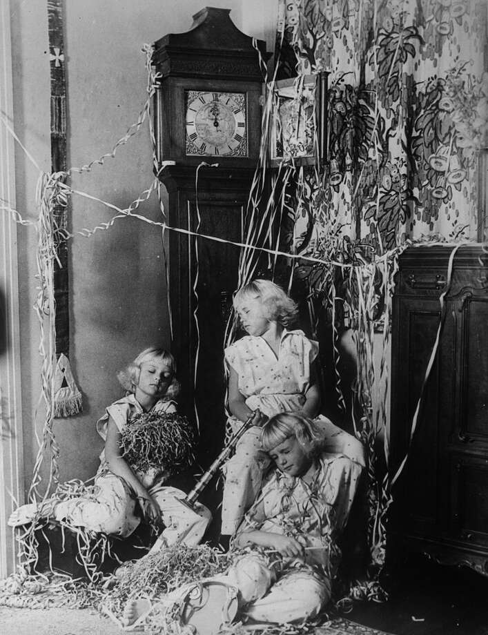 The Mawby triplets — Claudette, Angela and Claudine — are fast asleep before the clock strikes midnight to signal the New Year on Dec. 31, 1932. Photo: Fox Photos, Getty Images / Hulton Archive