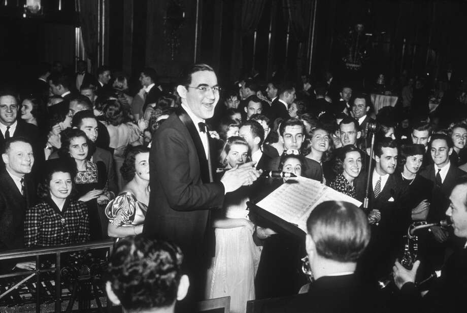 American jazz musician and bandleader Benny Goodman and his orchestra play for an enthusiastic audience during a New Year's Eve dance at the Waldorf Astoria, New York City on Dec. 31, 1938. Photo: Charles Peterson, Getty Images / Archive Photos