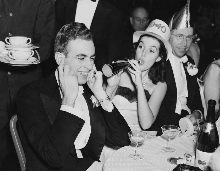 A woman blows a noisemaker during a New Year's party in 1940. Photo: KEYSTONE FRANCE, Getty Images / KEYSTONE FRANCE
