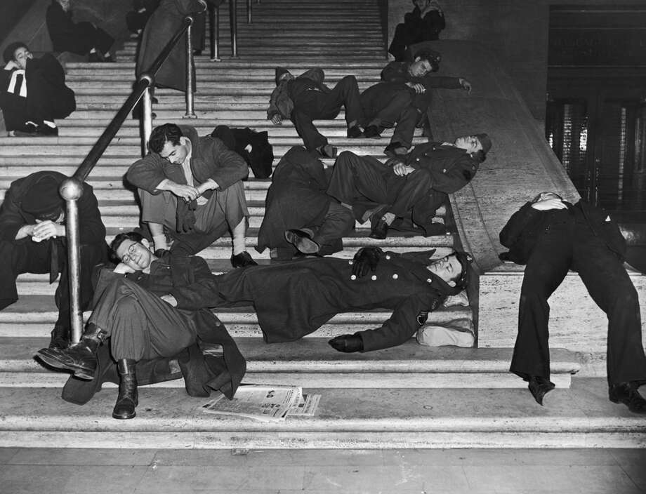 Revelers recover from New Year's Eve celebrations on the steps at Grand Central Station in New York City, circa 1940. Photo: FPG, Getty Images / 2008 Getty Images