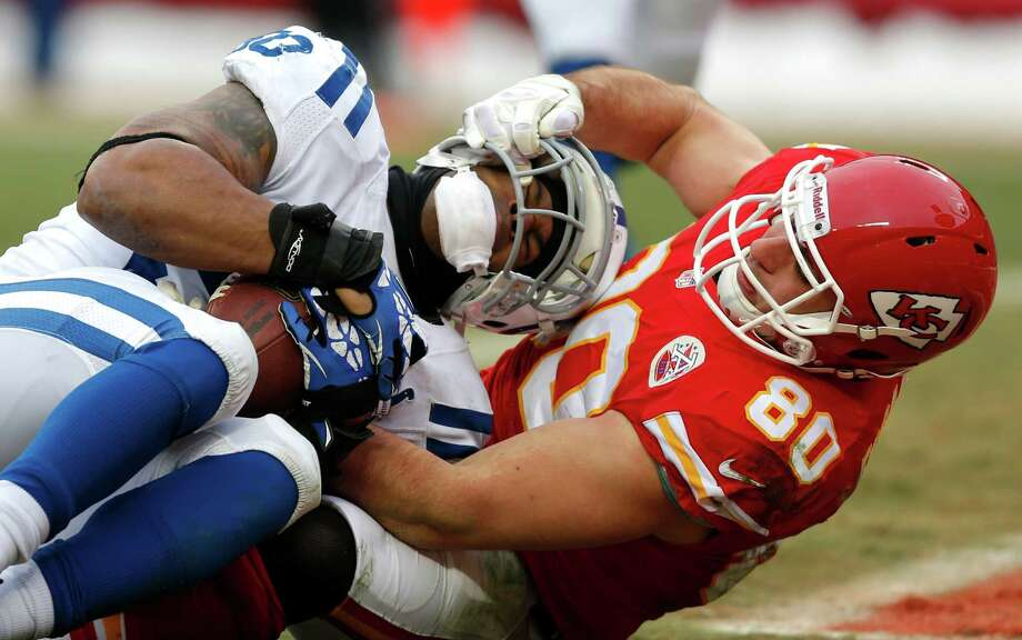 After Jerrell Freeman, left, intercepted a pass for one of the Colts' four takeaways, the Chiefs' Anthony Fasano responded by grabbing Freeman's facemask. Photo: Ed Zurga, FRE / FR34145 AP