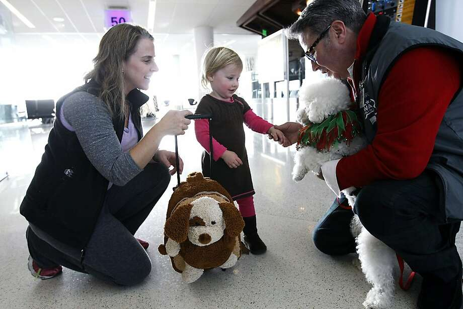 Top: Fabio Giuntarelli (right) and Lady Jenna Barbara welcome Stephanie Miller and daughter Molly. Photo: Michael Short, The Chronicle