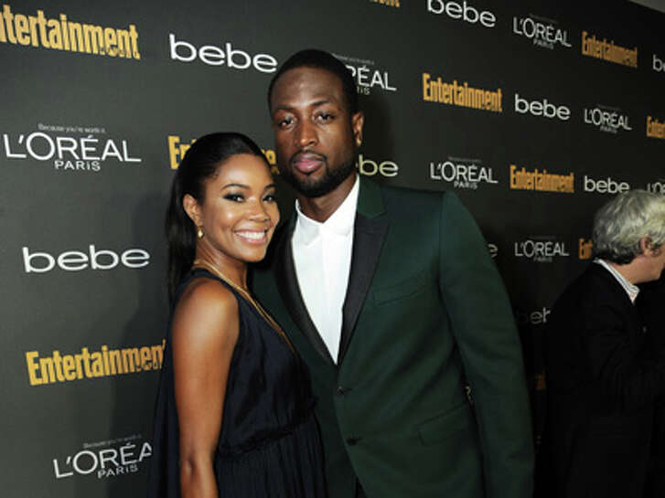From left, Gabrielle Union and Dwayne Wade arrive at the 2013 Entertainment Weekly Pre-Emmy Party, presented by L'Oreal Paris and bebe at Fig & Olive on Friday, Sept. 20, 2013, in Los Angeles. (Photo by Jordan Strauss/Invision for Entertainment Weekly/AP Images)