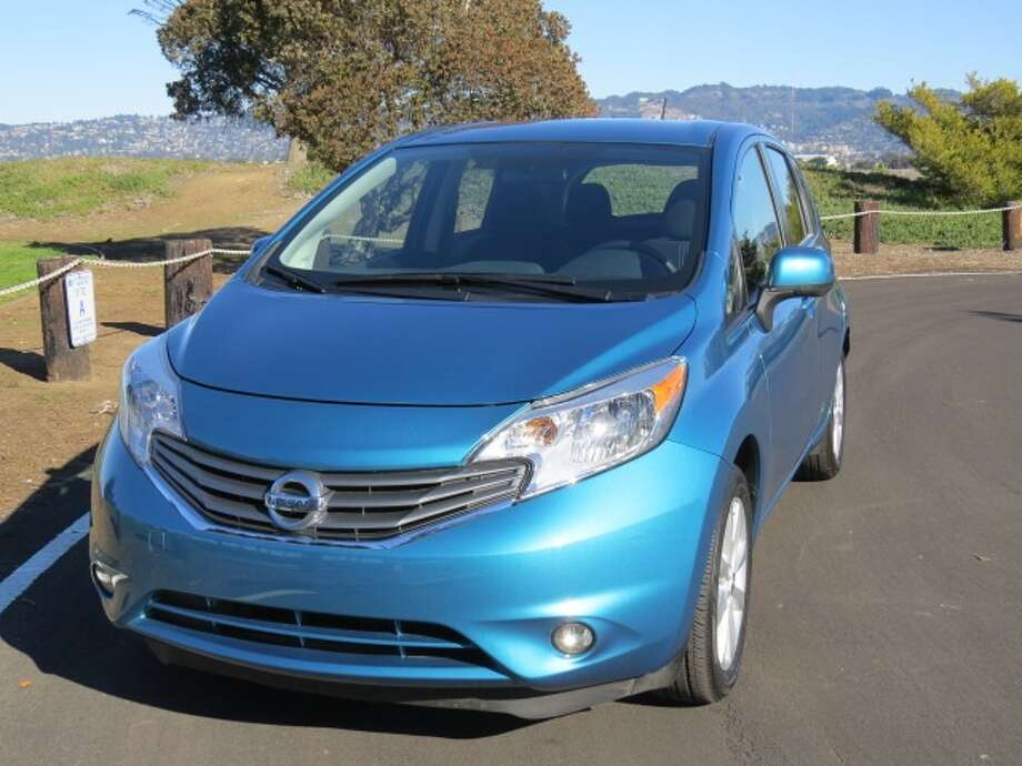 The 2014 Nissan Versa Note is one of many small cars that sell for under $20,000 and are easy on gas. The problem with the Note is that it does everything asked of it, but that's about it. Not much fun, not much flair. (All photos by Michael Taylor)