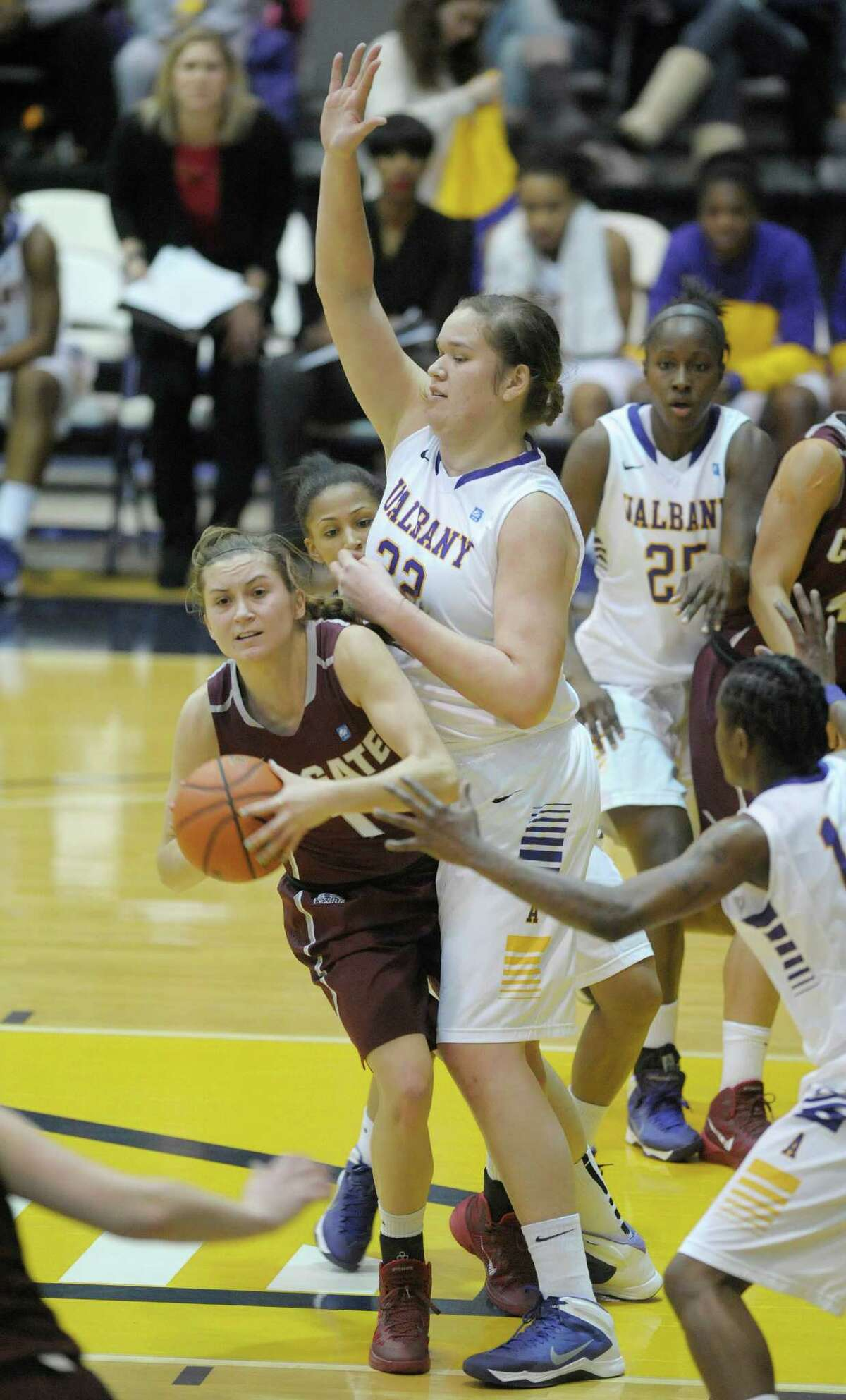 Lauryn Kobiela of Colgate, left, looks for an open teammate after being stopped in the lane by Megan Craig of UAlbany during the UAlbany and Colgate women's basketball game on Sunday, Dec. 22, 2013 in Albany, NY. (Paul Buckowski / Times Union)