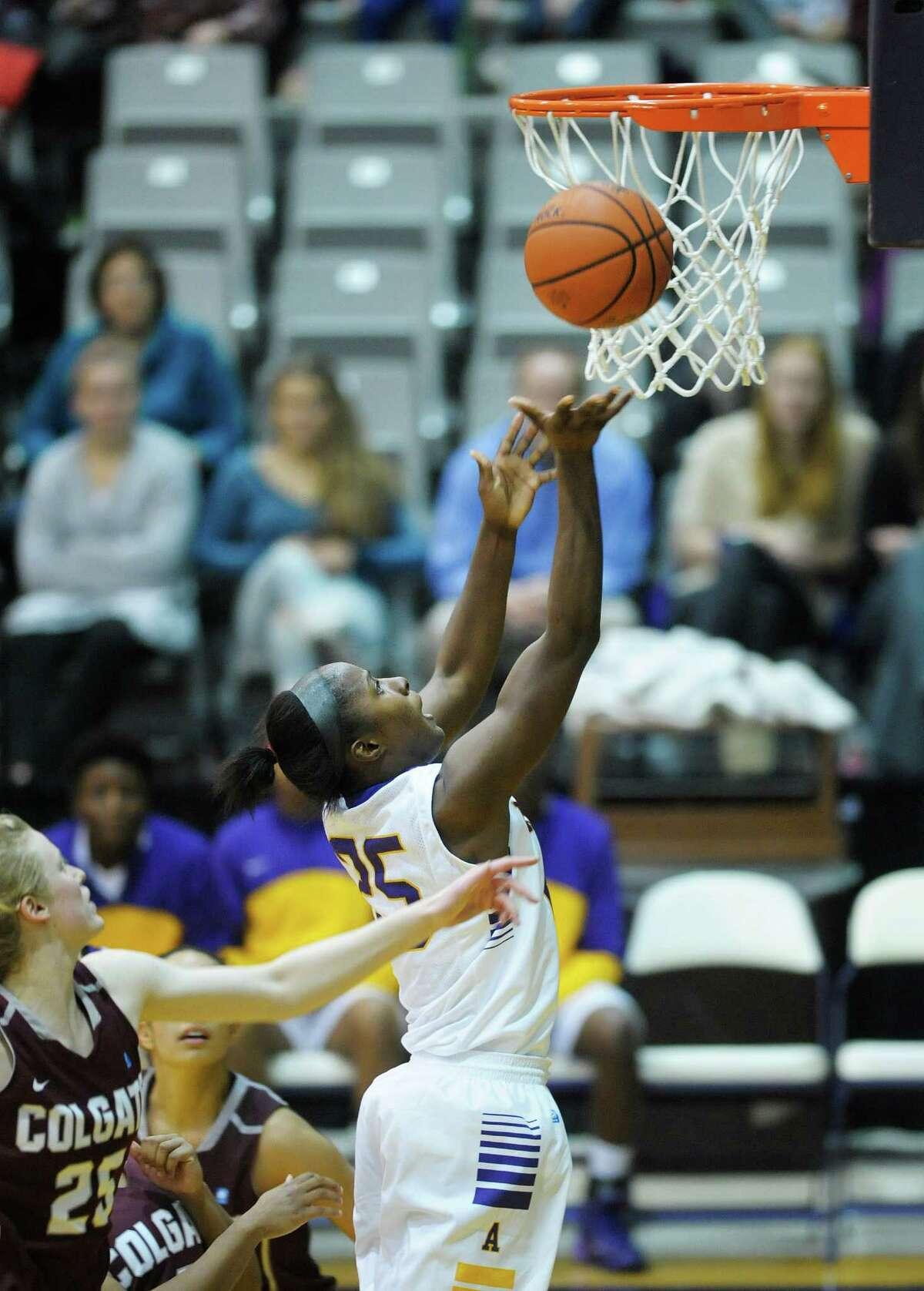 Shereesha Richards of UAlbany puts up a shot during the UAlbany and Colgate women's basketball game on Sunday, Dec. 22, 2013 in Albany, NY. (Paul Buckowski / Times Union)
