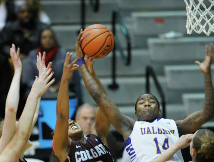 Tammy Phillip of UAlbany, right, grabs a rebound  during the UAlbany and Colgate women's basketball