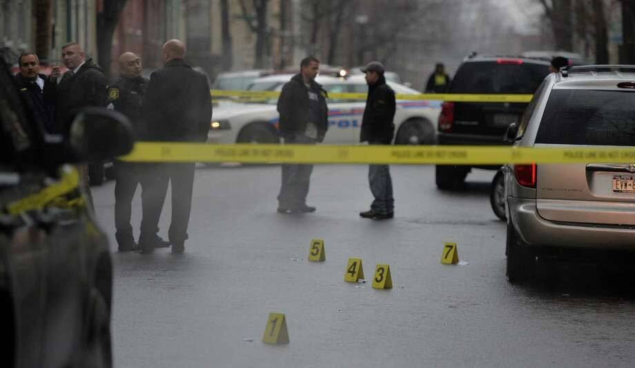 Albany Police are in the early stages of an investigation of a shooting that occurred Dec. 23, 2013 in Albany, N.Y. in the area of 90-100 Grand Street.  One person was transported to Albany Medical Center with gunshot wounds.  (Skip Dickstein / Times Union) Photo: SKIP DICKSTEIN