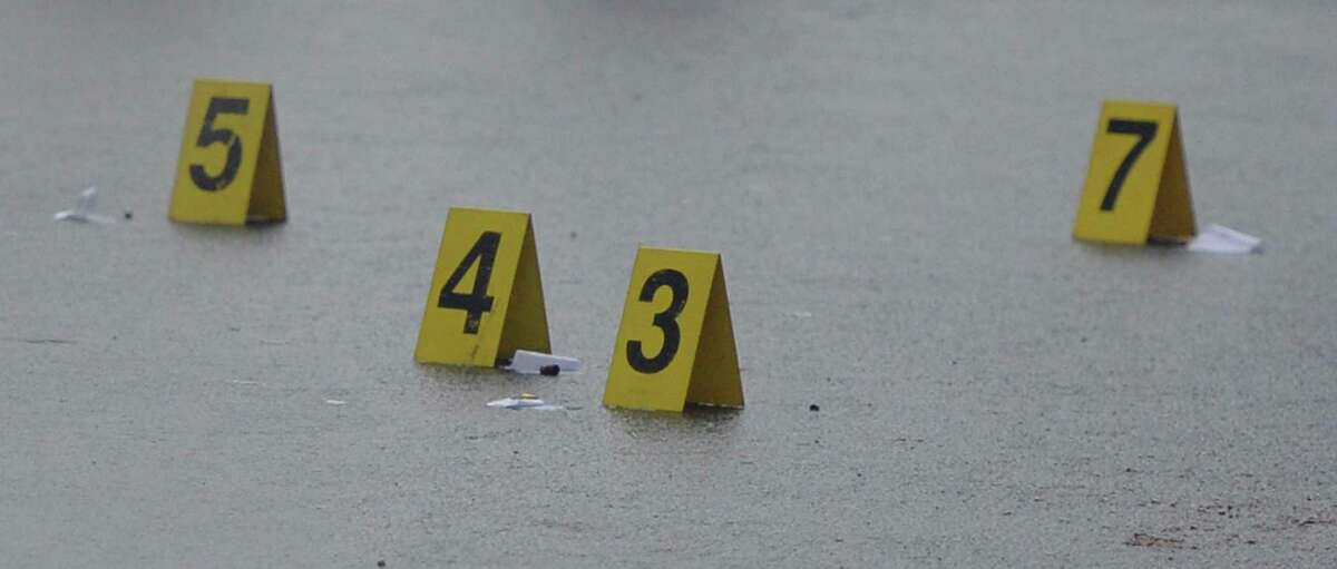 Evidence markers on Grand Street as Albany Police are in the early stages of an investigation of a shooting that occurred Dec. 23, 2013 in Albany, N.Y. in the area of 90-100 Grand Street. One person was transported to Albany Medical Center with gunshot wounds. (Skip Dickstein / Times Union)