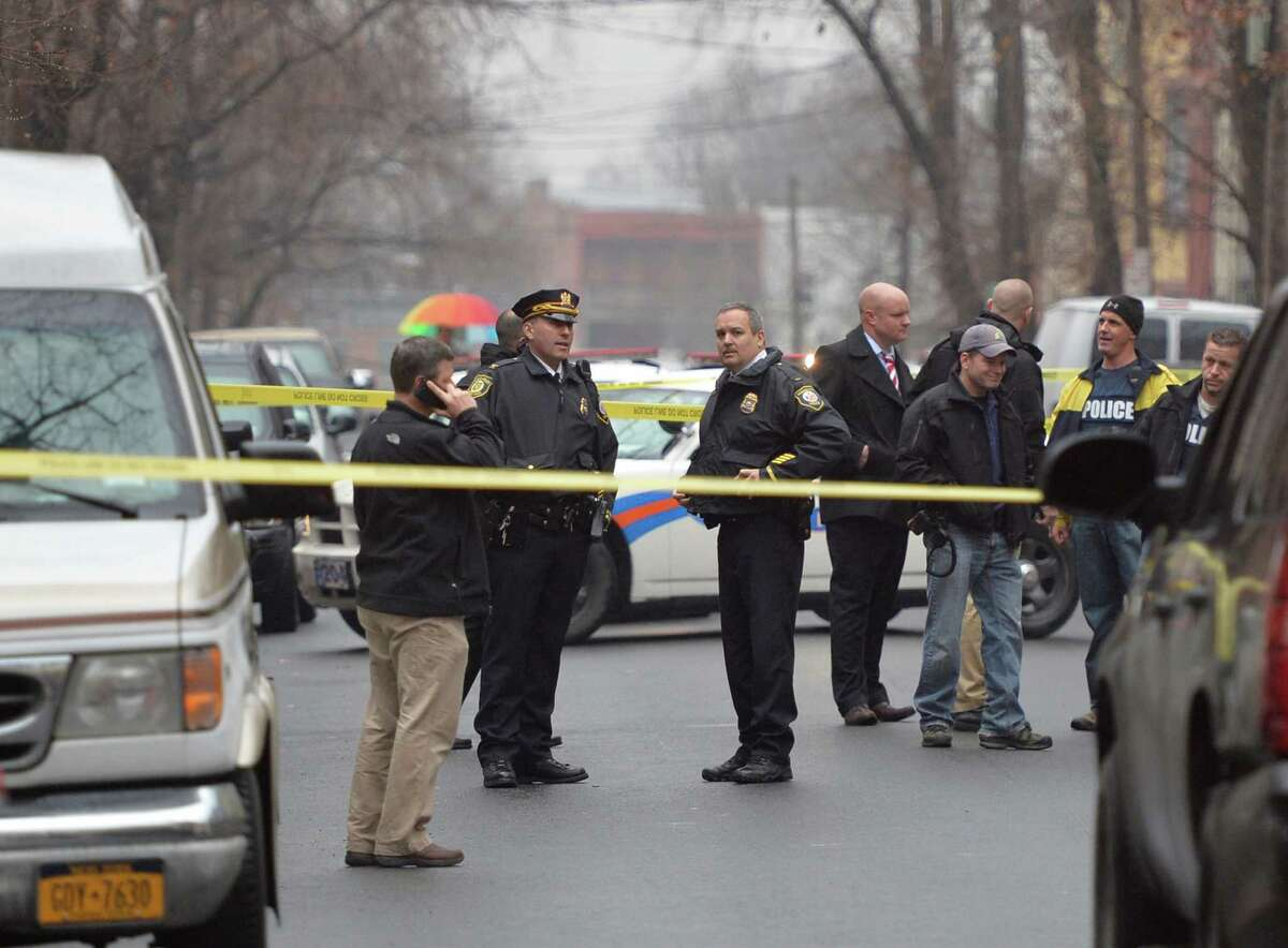 Albany Police are in the early stages of an investigation of a shooting that occurred Dec. 23, 2013 in Albany, N.Y. in the area of 90-100 Grand Street. One person was transported to Albany Medical Center with gunshot wounds. (Skip Dickstein / Times Union)