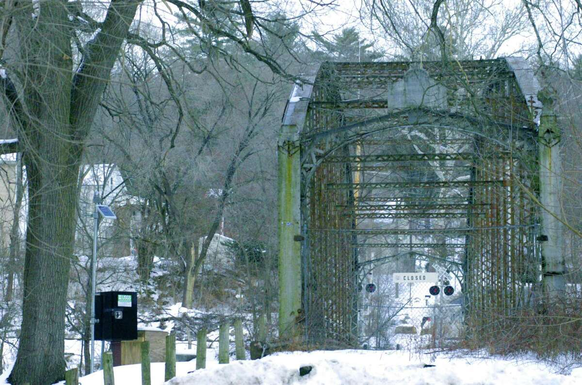 The Boardman Bridge has endured many years of neglect after serving for nearly a century as travelers' means of crossing the Housatonic River in the Boardman disitrict of New Milford. Dec. 19, 2013