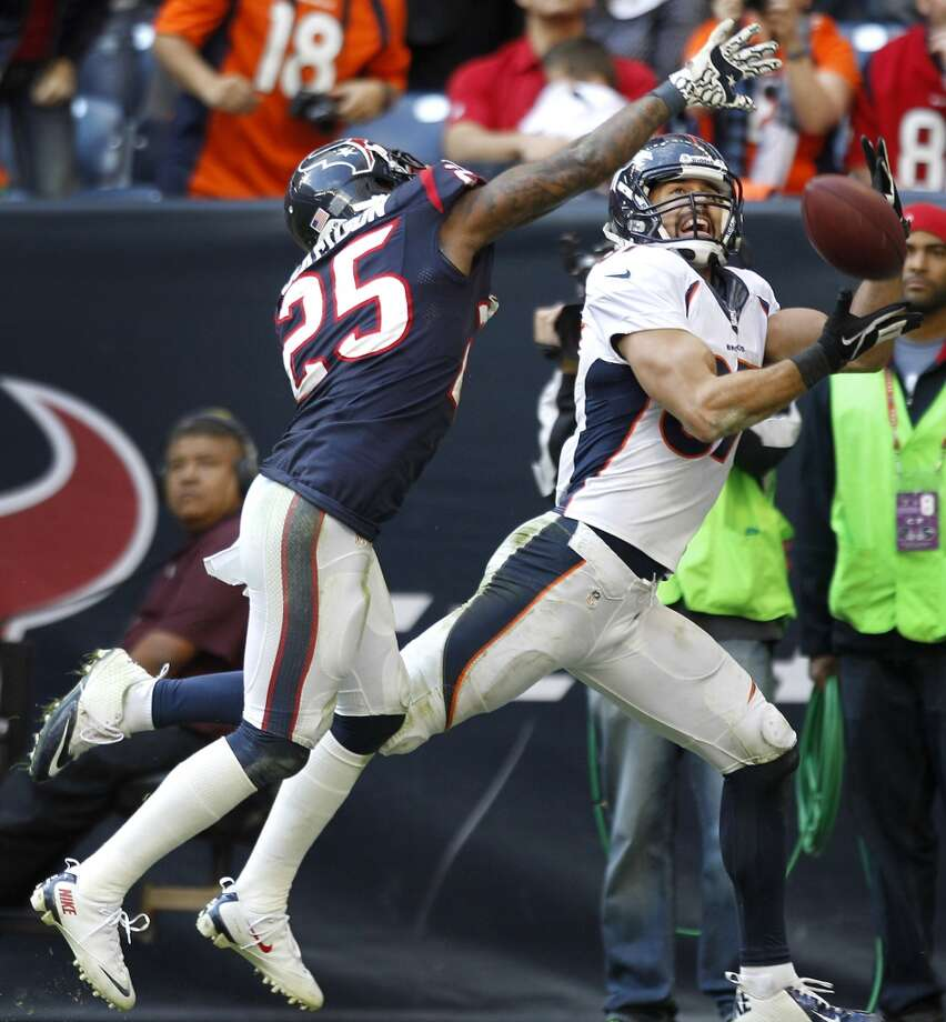 Broncos wide receiver Eric Decker (87) beats Texans cornerback Kareem Jackson (25) to catch a 20-yard touchdown pass from Peyton Manning. Photo: Brett Coomer, Houston Chronicle