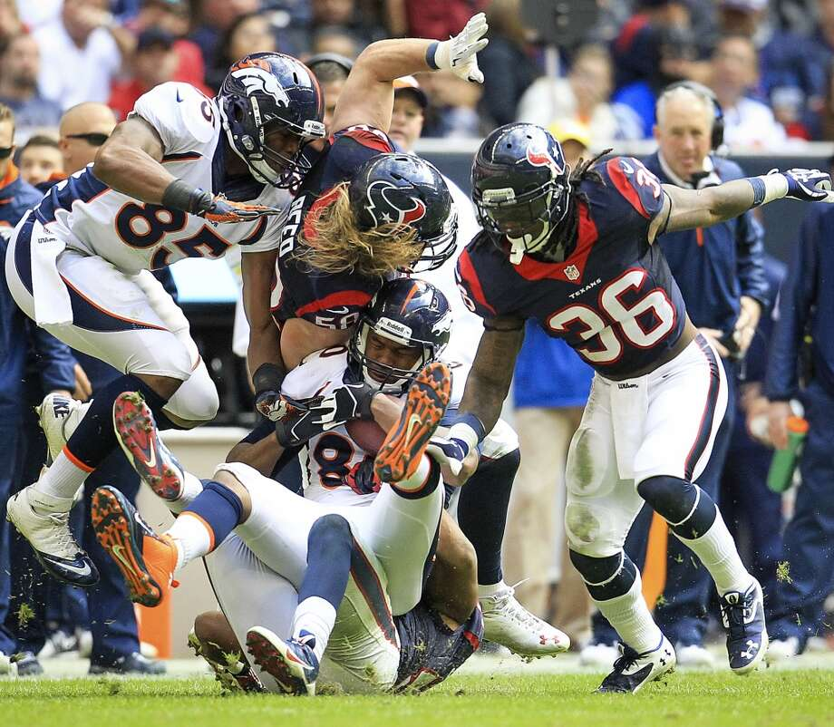 Broncos tight end Julius Thomas is brought down in a five player pileup. Photo: Karen Warren, Houston Chronicle