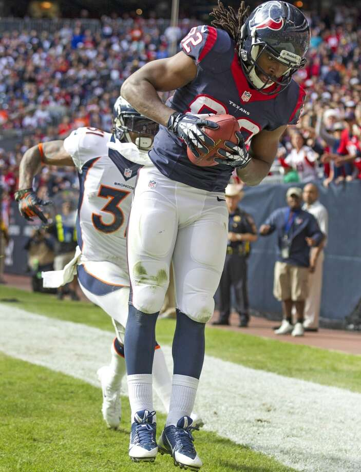 Texans wide receiver Keshawn Martin beats Broncos cornerback Omar Bolden for a 15-yard touchdown reception. Photo: Brett Coomer, Houston Chronicle