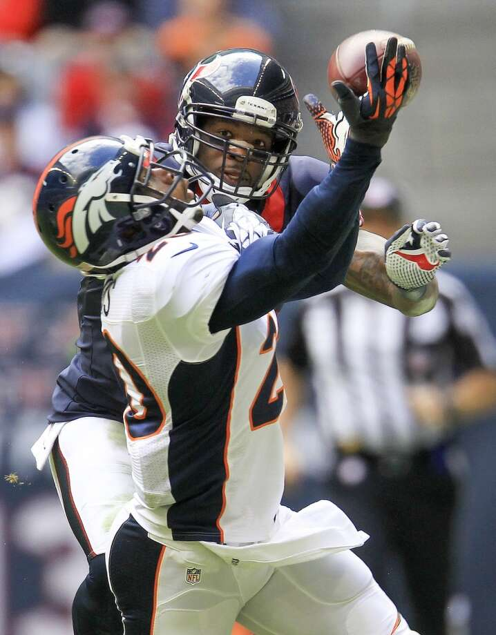 Broncos strong safety Mike Adams reaches for a pass intended for Texans wide receiver Andre Johnson. Photo: Karen Warren, Houston Chronicle