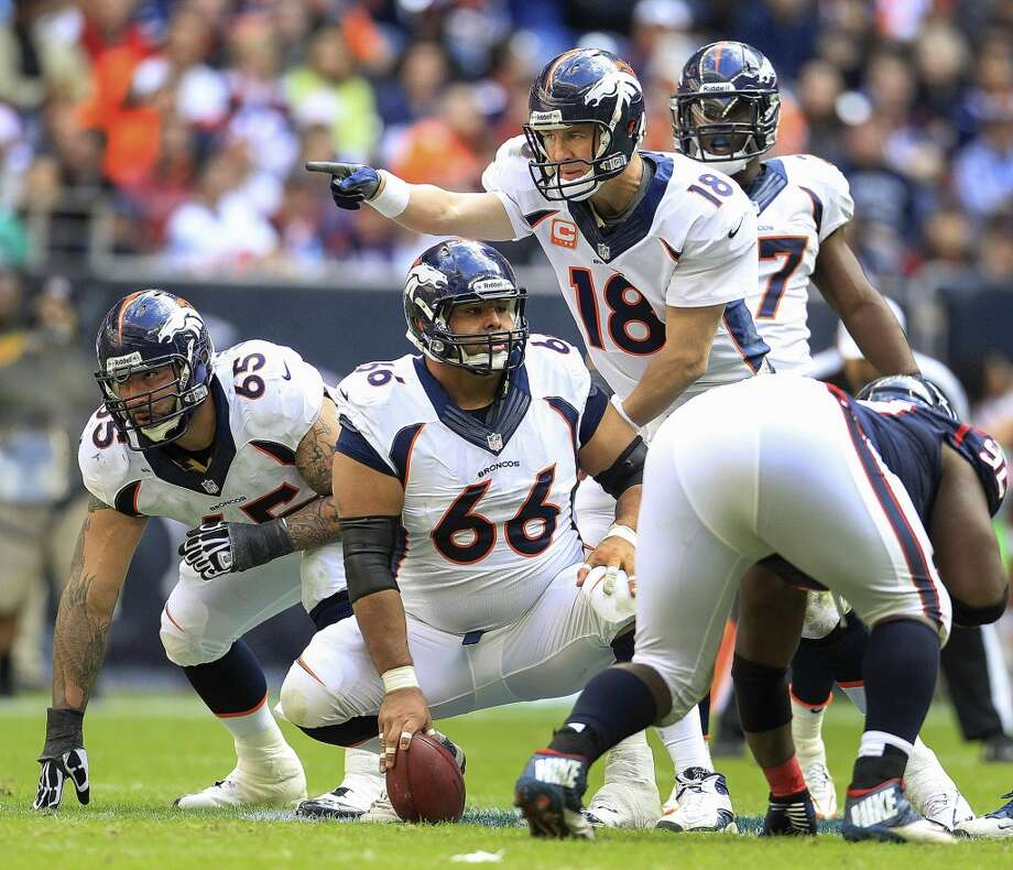 Broncos quarterback Peyton Manning brings his team to the line of scrimmage. Photo: Karen Warren, Houston Chronicle