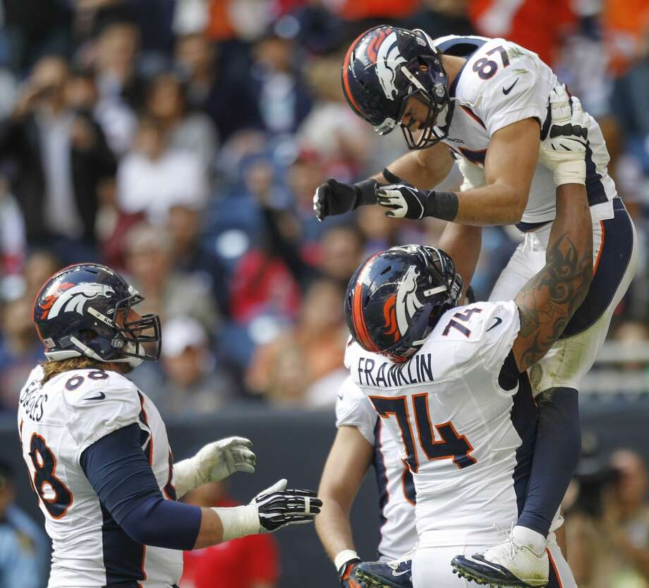 Broncos wide receiver Eric Decker (87) celebrates after a 20-yard touchdown reception. Photo: Brett Coomer, Houston Chronicle