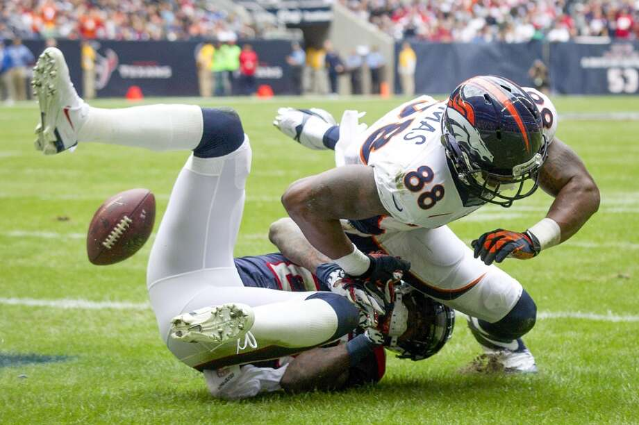 Texans cornerback Kareem Jackson breaks up a pass in the end zone intended for Broncos wide receiver Demaryius Thomas. Photo: Brett Coomer, Houston Chronicle
