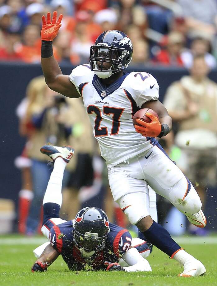 Broncos running back Knowshon Moreno runs past Texans cornerback Brice McCain. Photo: Karen Warren, Houston Chronicle