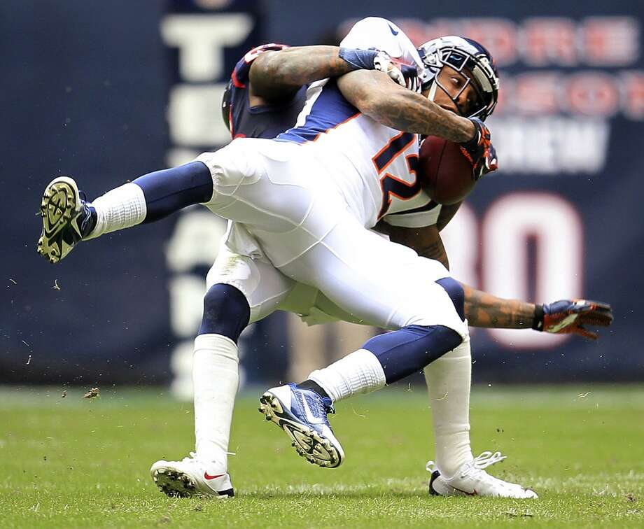 Broncos wide receiver Andre Caldwell is brought down by Texans cornerback Kareem Jackson. Photo: Karen Warren, Houston Chronicle