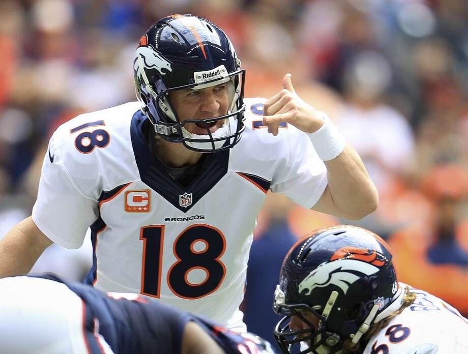 Broncos quarterback Peyton Manning signals at the line of scrimmage. Photo: Karen Warren, Houston Chronicle
