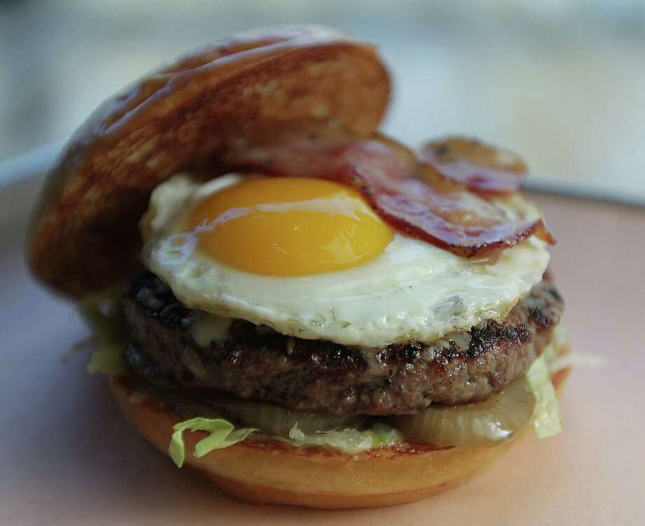 Fielding's Wood GrillCuisine: AmericanDish: smoke burger (house grilled bacon, aged Italian provolone, oven dried tomatoes, grilled onions, fried egg, truffle bacon mustard, lettuce, milk bun)Entree price: $$Where: 1699 Research Forest, ShenandoahPhone: 832-616-3275Website: fieldings.com Photo: James Nielsen, Staff / © 2013  Houston Chronicle