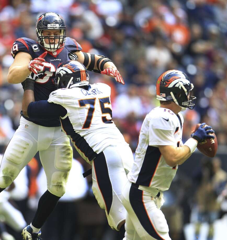 Week 16: Broncos 37, Texans 13  Texans defensive end J.J. Watt (99) jumps up as he tries to get past Broncos tackle Chris Clark (75) to get to quarterback Peyton Manning (18). Photo: Karen Warren, Houston Chronicle