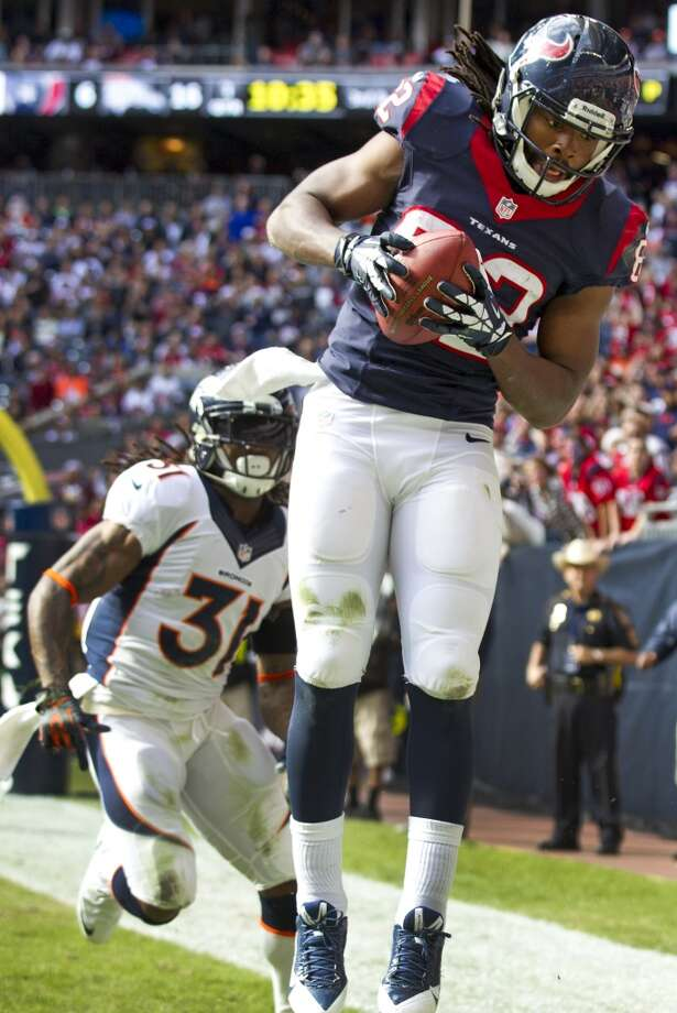 Texans wide receiver Keshawn Martin (82) beats Broncos cornerback Omar Bolden (31) for a 15-yard touchdown. Photo: Brett Coomer, Houston Chronicle