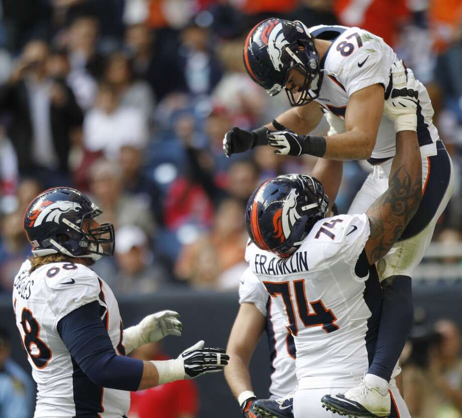 Broncos wide receiver Eric Decker (87) celebrates his 20-yard touchdown reception with guard Zane Beadles (68) and tackle Orlando Franklin (74). Photo: Brett Coomer, Houston Chronicle