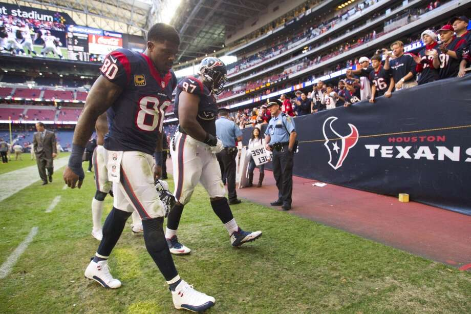 Texans wide receiver Andre Johnson (80) and defensive tackle Terrell McClain (97) walk off the field after the loss. Photo: Brett Coomer, Houston Chronicle