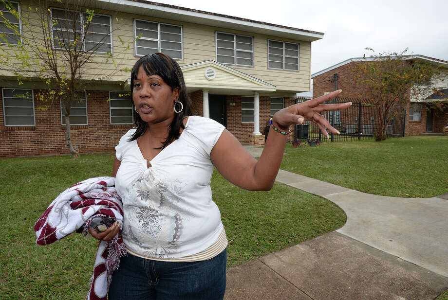 Andrea Robinson talks Friday about living in the 60-year-old Concord Homes near the former Fair Park Colosseum. The local Housing Authority hopes to demolish the structure and rebuild, but an Austin based organization claims it will block construction saying the Authority's efforts confine poor people to poor areas.  Photo taken Friday, December 20, 2013 Guiseppe Barranco/@spotnewsshooter Photo: Guiseppe Barranco, Photo Editor