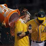 Josh Donaldson is doused by gatorade after hitting a walk off hit in the bottom of the ninth. The Oakland Athletics played the Los Angeles Angels at O.co Coliseum in Oakland, Calif., on Tuesday, September 17, 2013, and defeated the Angels 2-1 on a walk off hit in the bottom of the ninth.