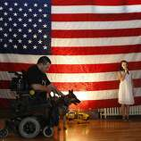 Marine staff Sgt. Jason Ross and his dog Gracie arrive to his homecoming event on Saturday, April 27, 2013, at the County of Alameda Veterans Memorial bldg. in Livermore, Calif.   Jason lost both legs two years ago while on patrol in Afghanistan.  Jason has since had 200 surgeries  and this is his first time back to visit his hometown since his injury.