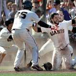 The Giants' Marco Scutaro, (left) Brandon Crawford, (35) Angel Pagan, (16), and Andres Torres, (behind) celebrate Pagan's the winning run an inside the park homer  in the tenth inning as the San Francisco Giants beat the Colorado Rockies 6-5 in Major League Baseball action at AT&T Park on Sat. May 25, 2013, in San Francisco, Calif.