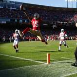 Michael Crabtree scores a touchdown during the San Francisco 49ers game against the Arizona Cardinals at Candlestick Park in San Francisco, Calif., on Sunday December 30, 2012.