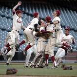 The Lowell Cardinals rush the field after they defeated the Washington Eagles on Wednesday. The Lowell High School Cardinals played the Washington High School Eagles in the San Francisco CIF Spring Championships at AT&T Park in San Francisco, Calif,. on Wednesday, May 8, 2013.